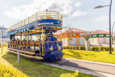 blue trolley in front of Aruba's cruise terminal